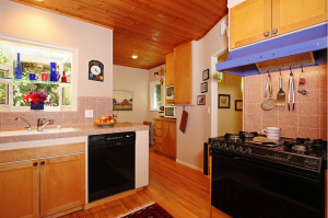 You can't see it very well from this angle, but the table and chairs are in the back of the kitchen on the right.